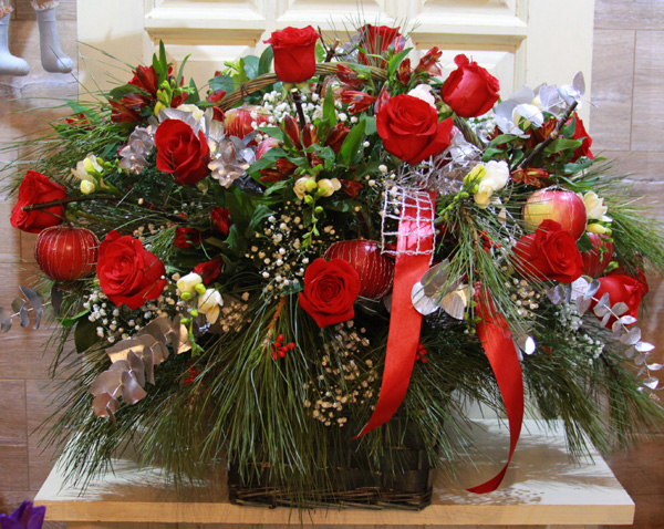 basket with red roses, freesias, alstroemerias