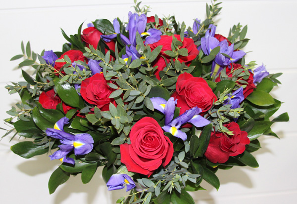 bouquet of red roses, blue irises