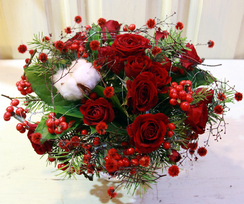 bouquet of red spray roses, winterberries