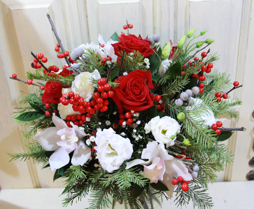 bouquet of white orchids, red roses, red winterberries, lisianthus